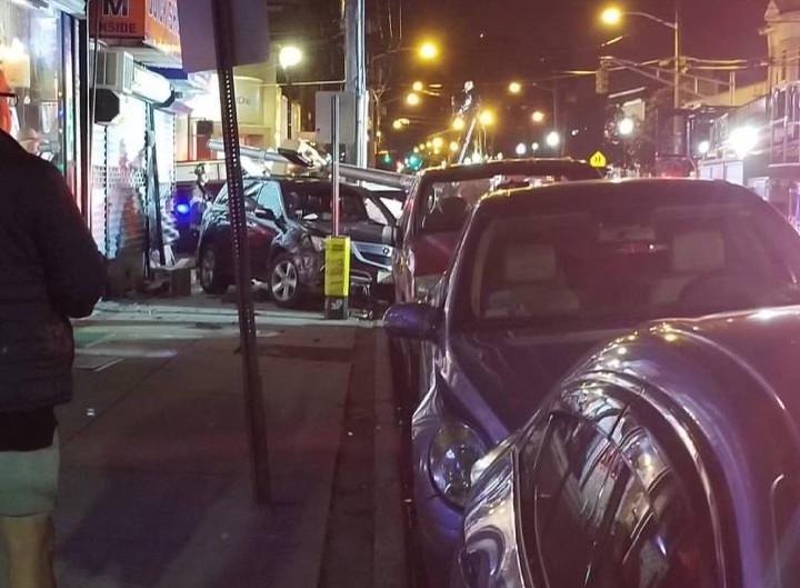 Photos: Car crashes onto sidewalk on 60th St. in West New York