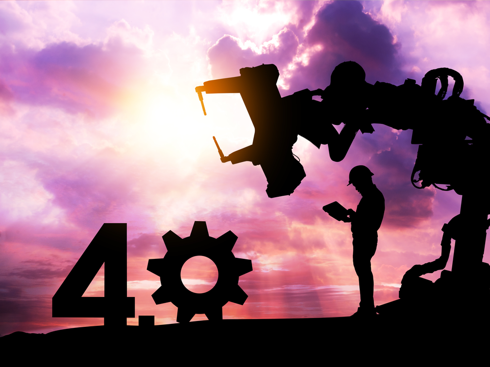 Silhouette of business man command automation robot arm machine technology , industry 4.0 , artificial intelligence trend concept. Sunrise twilight background. | Manufacturing Trends Unfolding in 2020