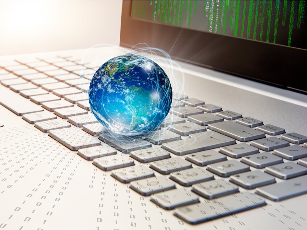 """Glass globe on laptop keyboard """"Elements of this image furnished by NASA."""""""