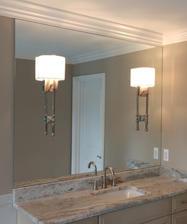 Custom vanity mirror with floating sconces.