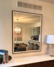 Custom mirror with frame.
