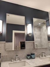 Custom mirrors. Created custom brakets to float mirrors in front of the tile.