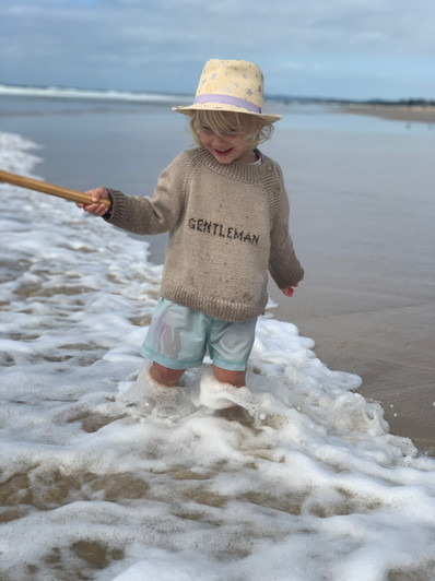 Hugo enjoying the beach in winter