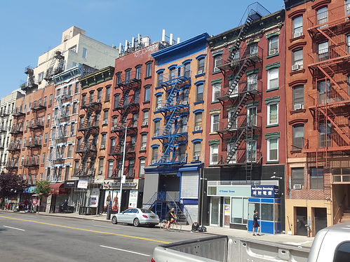 Row of colorful tenement buildings