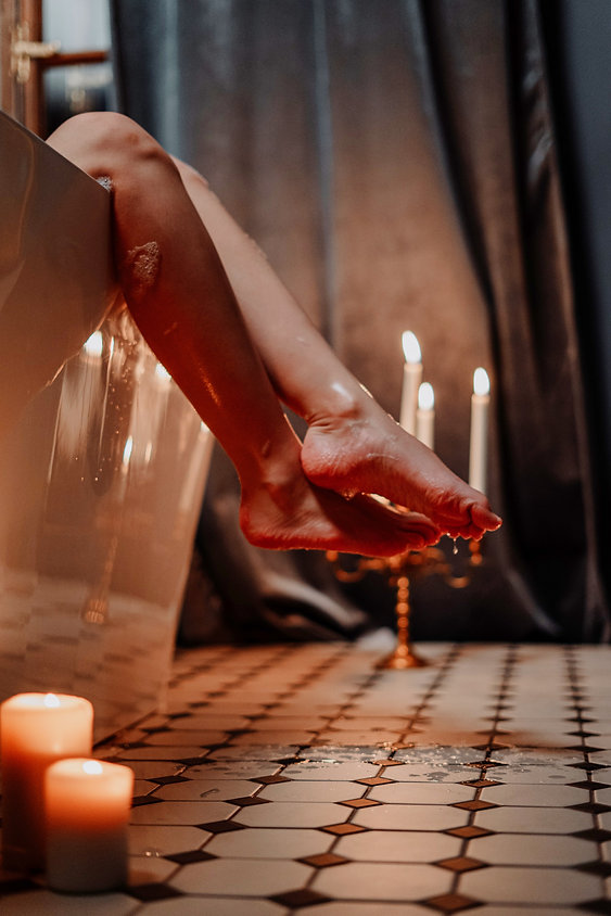 person-holding-lighted-candle-on-table-4