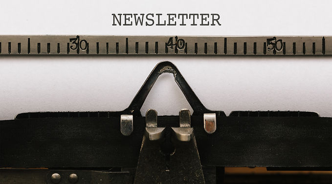paper-with-newsletter-text-in-old-typewriter-ZZCULEG.jpg