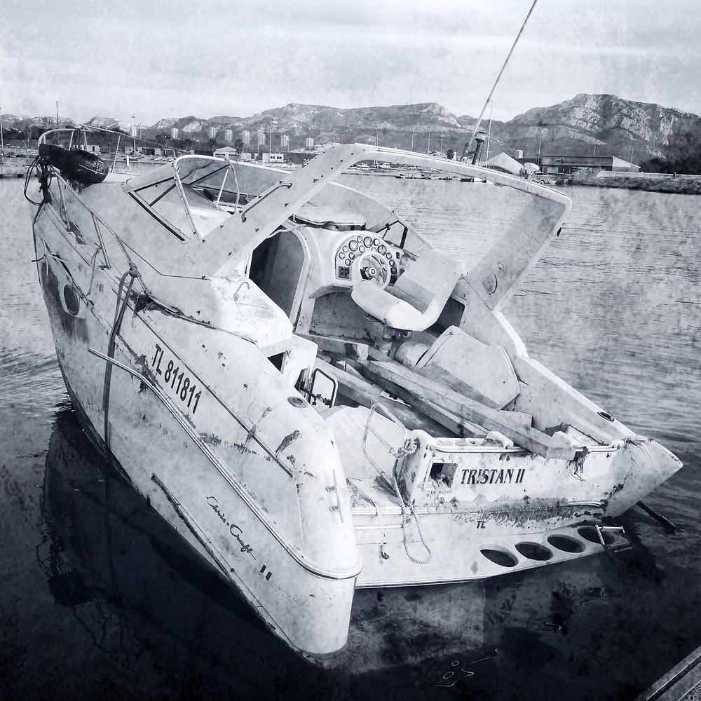 An abandoned boat rotting on the shore