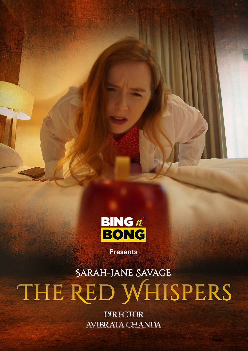 A woman peers over a bed at a mysterious red box; the title of the film and director, producer and star credits