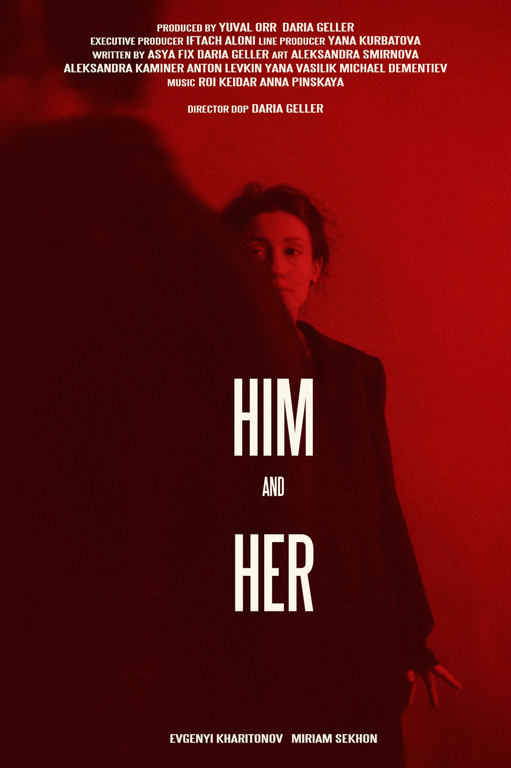 A red poster, with one figure to the left of the image in shadow as he looks off camera and a young woman in the centre watching him in intrigue and perhaps dislike.