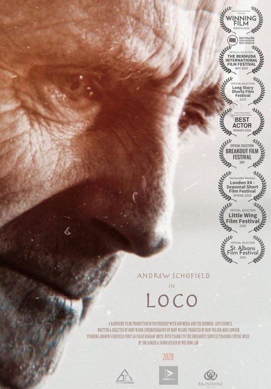 Extreme close up on an older man looking down with sad expression; the film's title and credits as well as its awards and nominations at film festivals are listed
