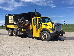 Our side-load garbage cart trucks dump 64 or 95 gallon carts weekly in rural acreages, farms, and towns.