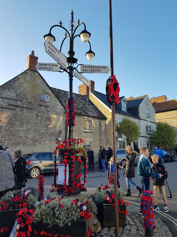 Remembrance day decorated signpost in sq