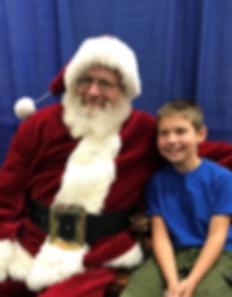 Caleb Busby shares time with Santa.jpg.p