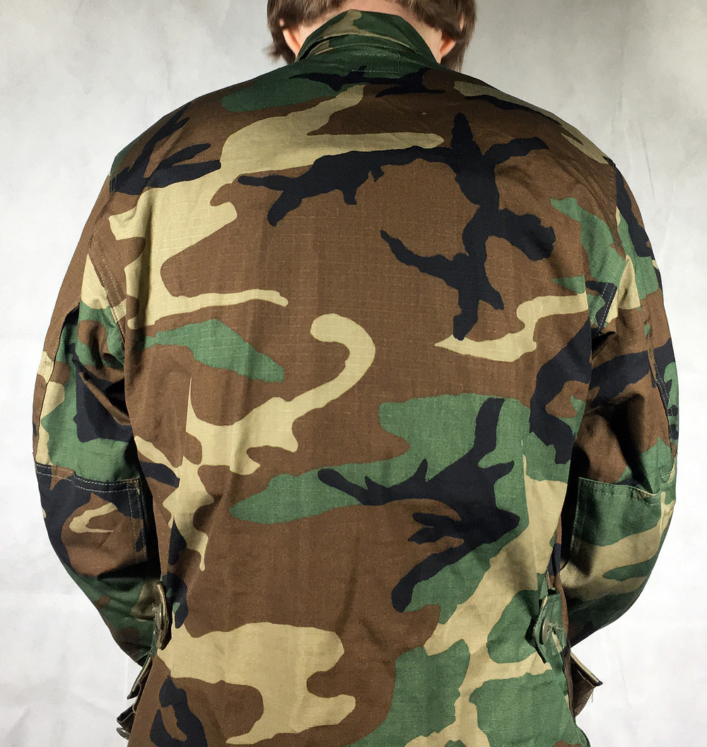 Woodland jacket and concealable rifle plates