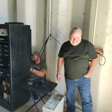 K3UKE and KB3VSP making adjustments with the service monitor.