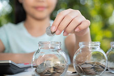 cute-asian-little-girl-playing-with-coins-making-stacks-money-kid-saving-money-into-piggy-