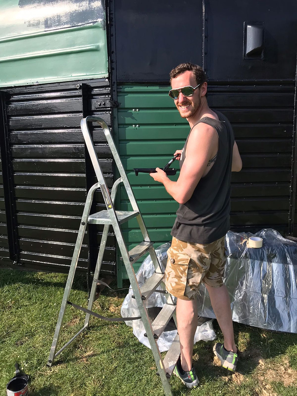 Sam painting the trailer