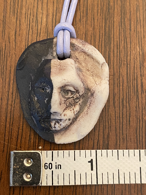 Faces of Humanity Pendant