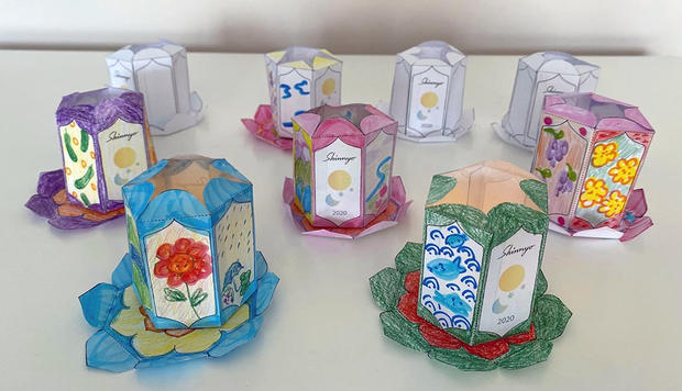 A group of decorated and personalised lanterns.
