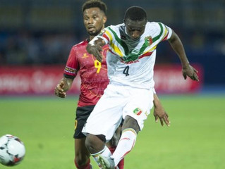 Mali advanced to the last 16 of the Africa Cup of Nations as Group E winners after beating Angola 1-