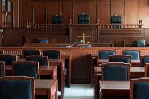Table and chair in the courtroom of the