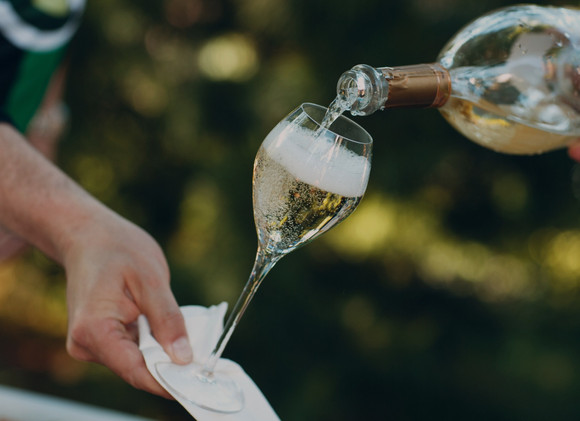 waiter-pouring-champagne-into-glass%20(1)_edited_edited.jpg