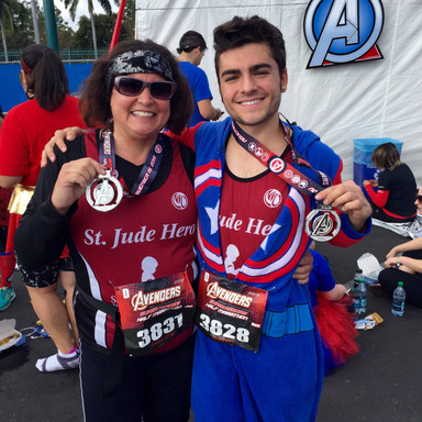 Marlene and Austen receiving their medals for completing the Avengers Superheroes Half Marathon