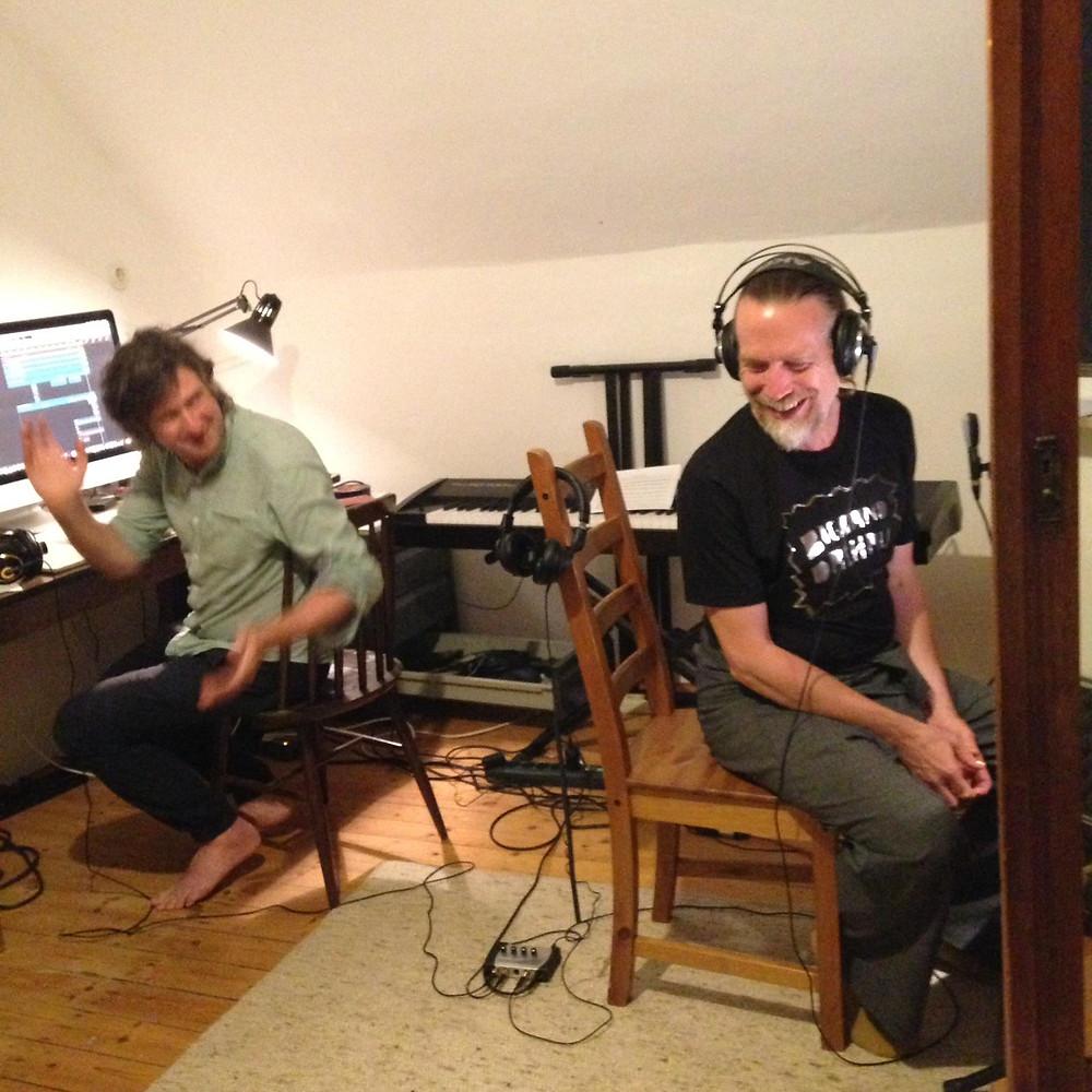 JJ Jones recording vocals with Ian Chapman acting as sound engineer
