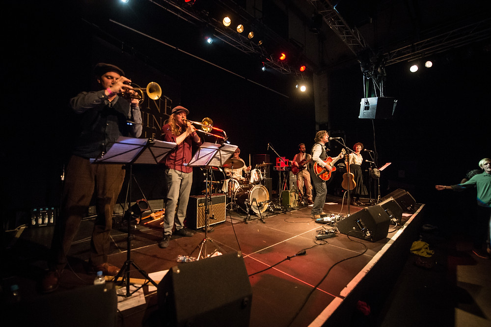 The Lone Dining Society onstage at The Sound Of Munich Now Festival 2019 Julian Hesse (trumpet) Thorben Schütte (Trombone) Johannes Url (Drums) Ian Chapman (Guitar/vocals) Carles Camós (Bass) Eileen Byrne (Backing Vocals / Melodica)