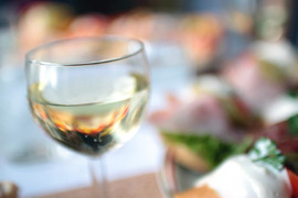 close-up-of-white-wine-glass-on-table-in