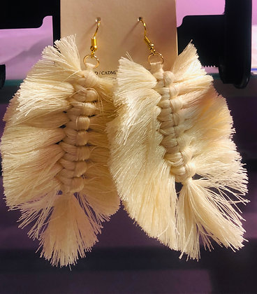 Cream colored, feathered cloth earrings