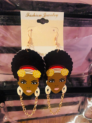 Cream colored earrings with hanging gold chain