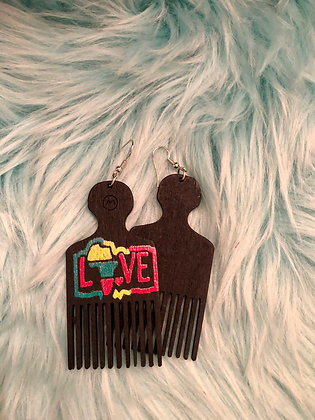 Black 'pick' earrings with Love embossed on front.