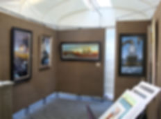 Outdoor Art Show Booth with original paintings on display.