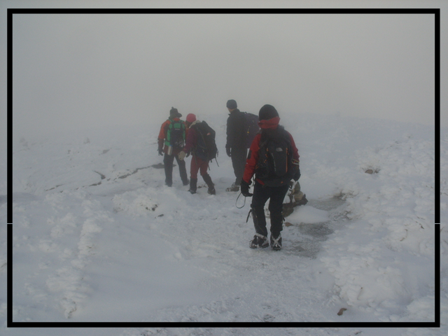 Nearing the summit of Algonquin Peak, Lake Placid in near whiteout conditions.