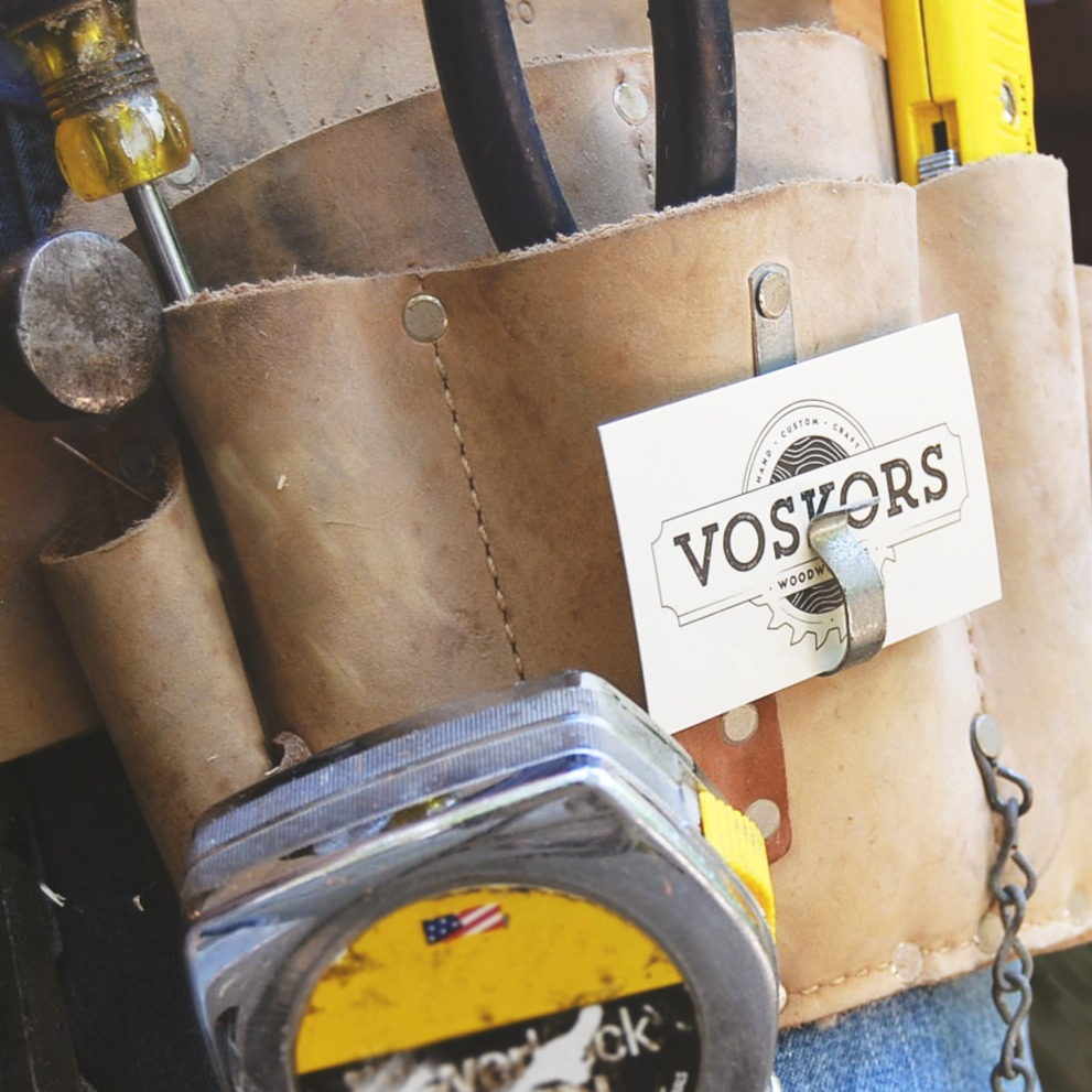 Voskors' business card in tool belt
