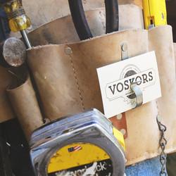 Voskors' business card in tool belt