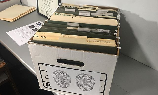 Aged paperwork, folders and boxes are av