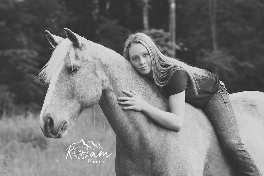 Girl lying on her horse