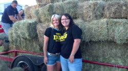 Britt and Kylie helping the hay driv