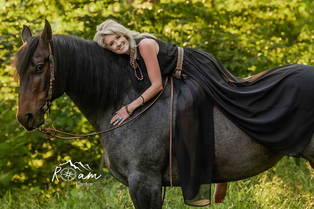 Beautiful woman hugging her horse