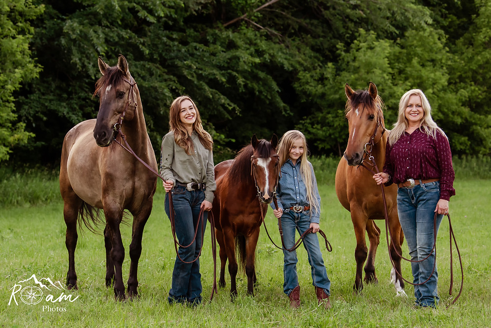 Mother and her two daughters and horses.