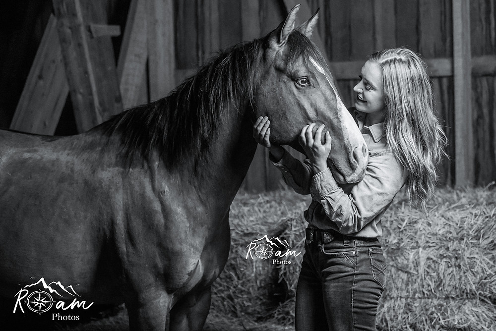 Girl looking lovingly at her horse