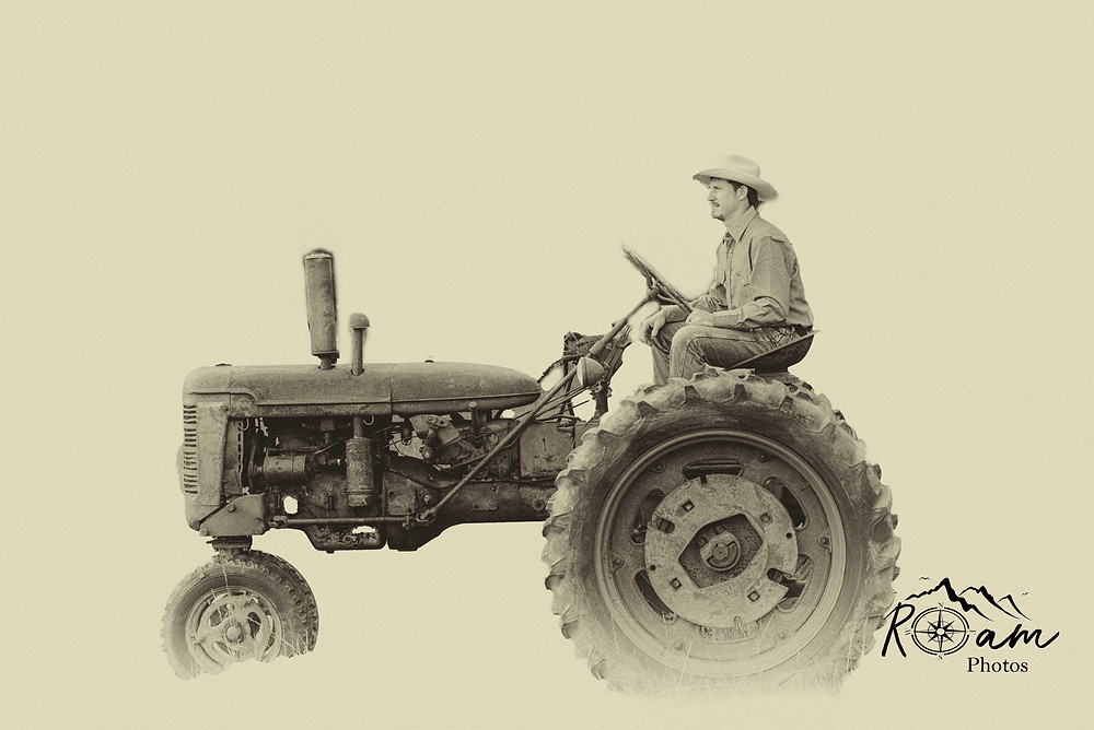 Cowboy on an old tractor.