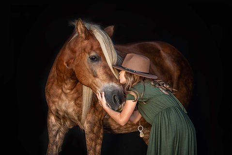 Young girl kissing her horse