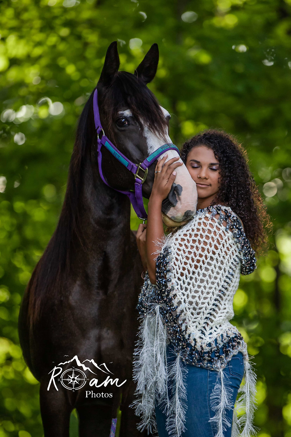 equestrian of color woman hugging her horse