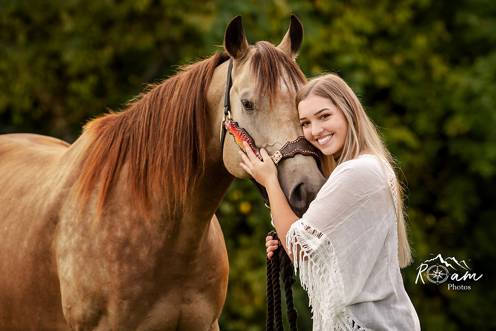 Beautiful young girl with her horse.