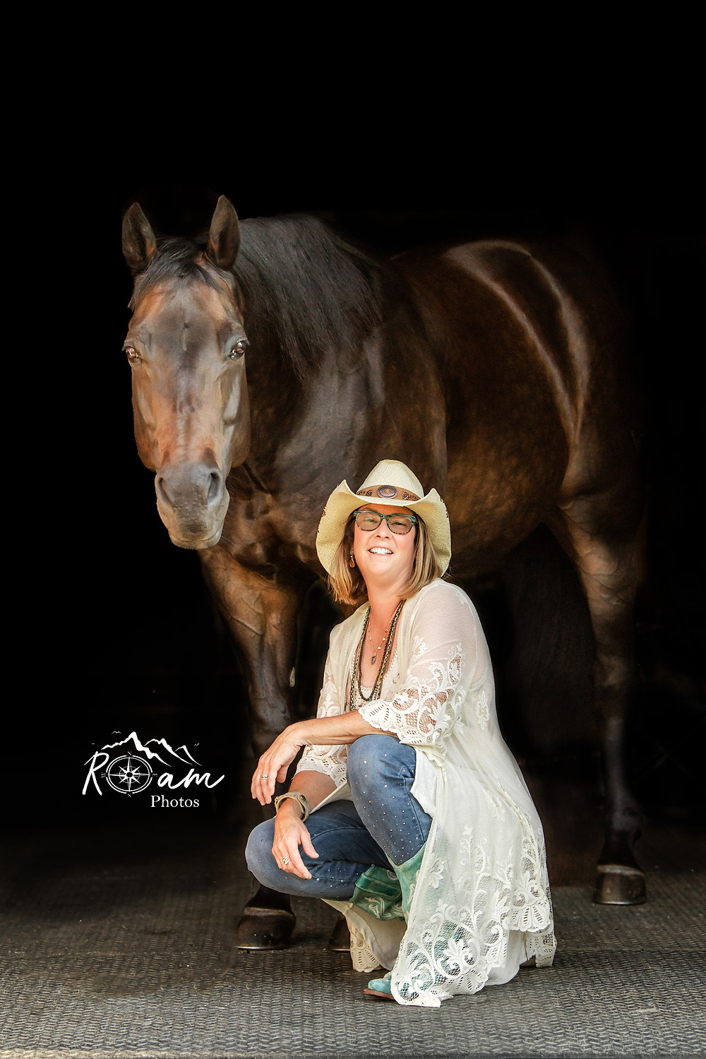 Pretty cowgirl with her horse