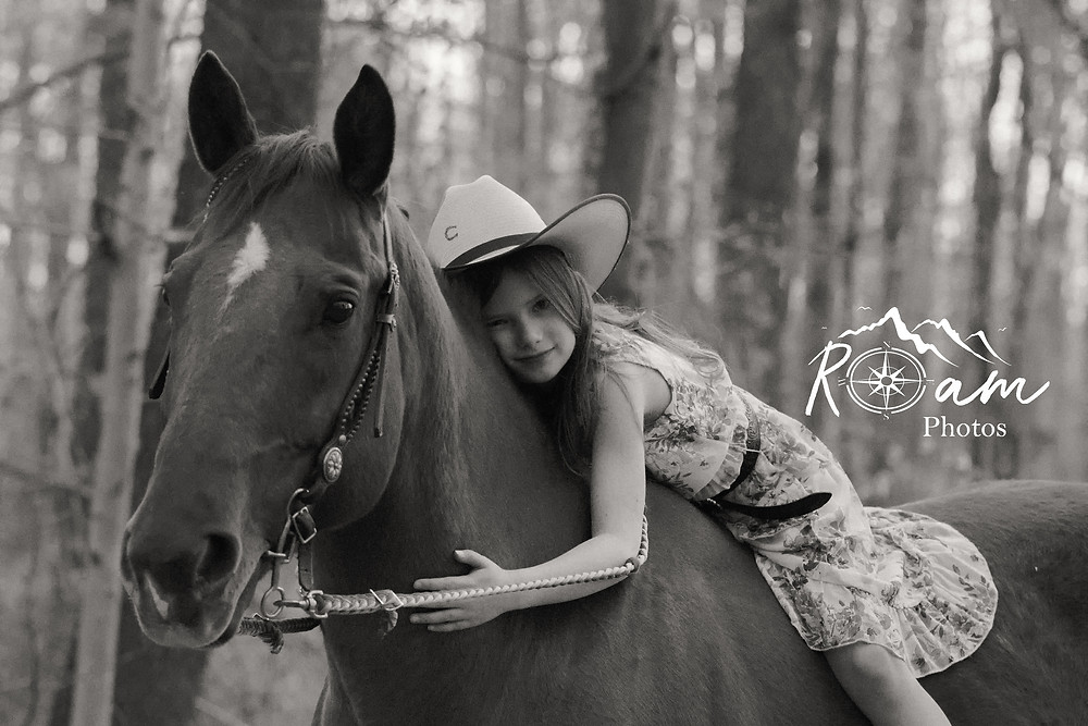 Little Cowgirl hugging her horse