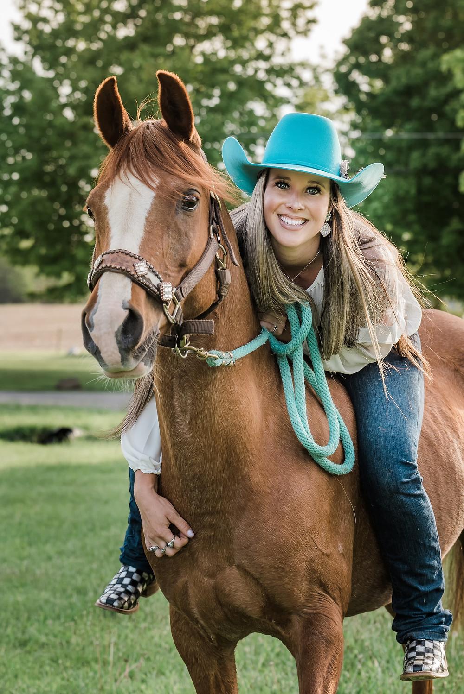 Beautiful cowgirl on Arabian horse